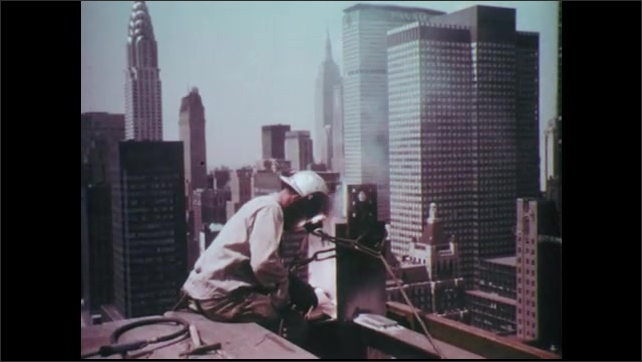 1960s: Marine pulls trigger and anti-tank gun fires. Tank blows up. Man welds on top of skyscraper in NYC. Steel girders are put in place with cables.