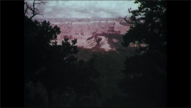 1960s: View of the Grand Canyon. Men in cowboy hats saddle horses.