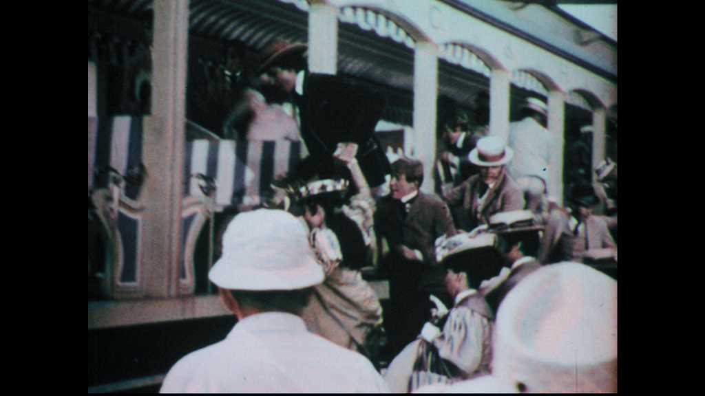 1960s: Characters in costume crowd onto streetcar and move in synch as film crew records the scene. Barbra Streisand smiles and sticks out her tongue.