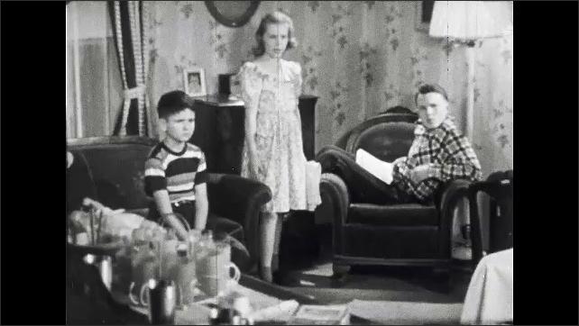 1950s: UNITED STATES: Lady speaks to children. Children in lounge. Girl sulks. Children speak t mother.