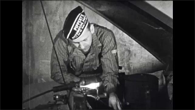 1950s: UNITED STATES: Man fixes car engine. Mechanic works on car.