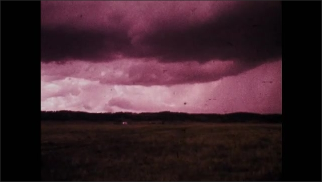 1970s: UNITED STATES: clouds forming in sky. Tornado touches down in Indiana. Turbulence grows as tornado hits.