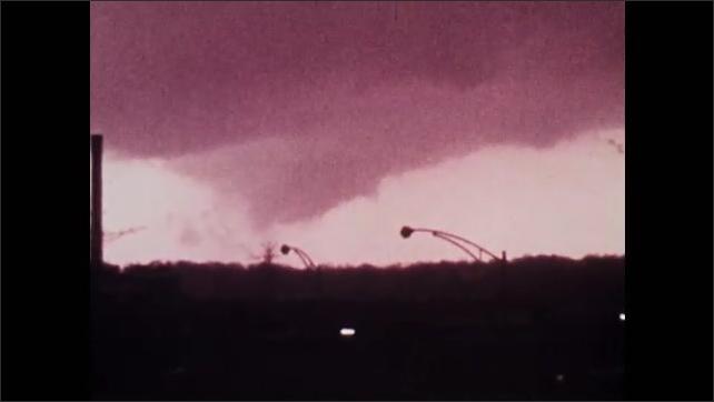 1970s: UNITED STATES: tornado travels towards camera. Debris around tornado.