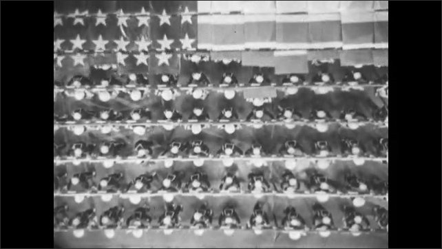 1940s: Planes take off from carrier. Soldiers waves hats and watch planes leave ship.