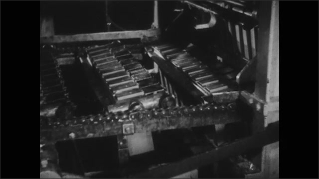1940s: UNITED STATES: boxes on machine. Machine packages boxes. Powdered eggs in boxes on conveyor