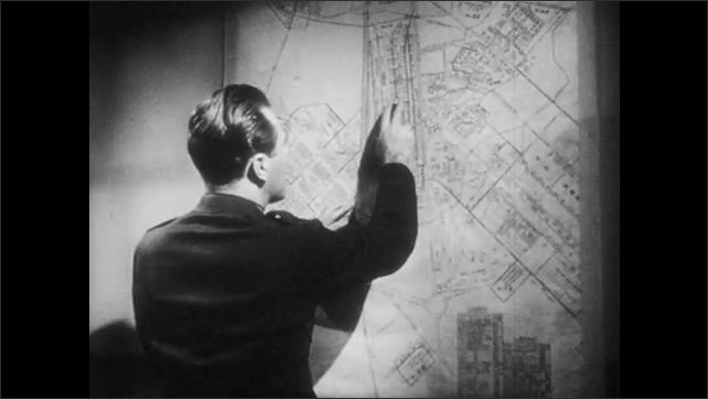 1950s: UNITED STATES: police man speaks on phone, Officer in uniform. Man looks at map on wall. Man puts down telephone