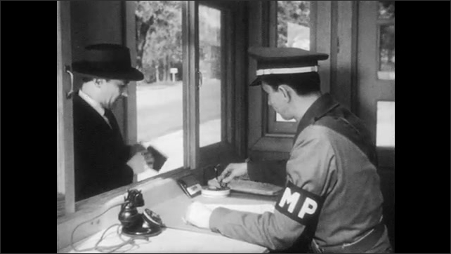 1950s: UNITED STATES: Sample buttons on display. Green, Plain, Blue, and Red buttons. Hand signs document. Guard gives button to visitor. Visitor signs register