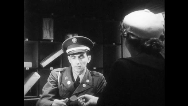 1950s: UNITED STATES: man works in check room. Lady drops off pass. Man gives package to lady. Man in uniform.