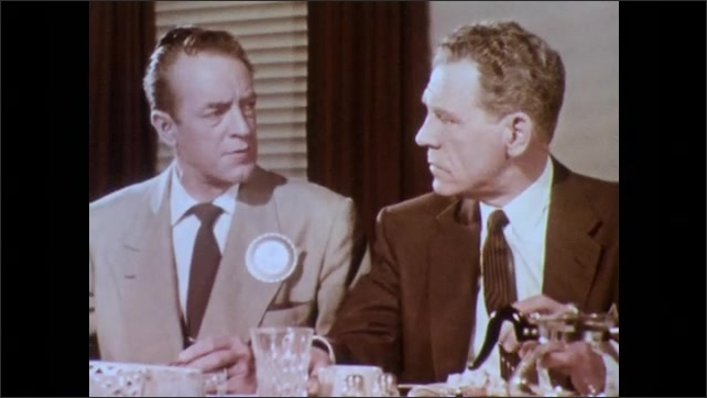 1950s: Luncheon.  Men sit and talk.
