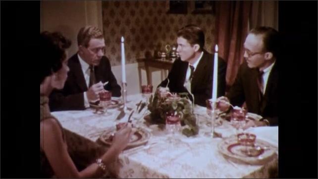 1950s: Dinner party.  Woman leaves table.  People speak.
