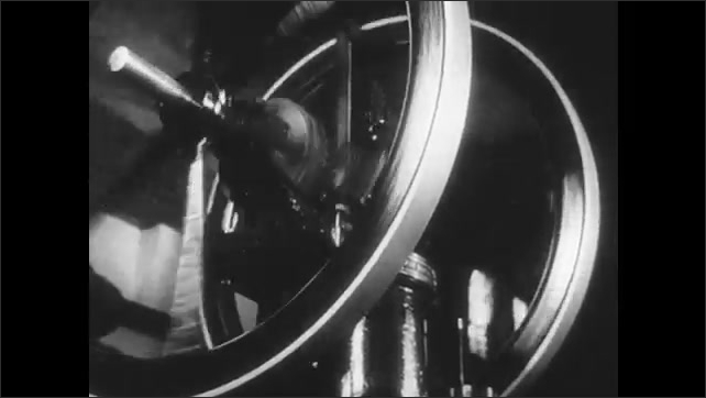 1950s: UNITED STATES: internal combustion engines at work. Steam powered machine at work. Four stroke cycle theory development. Machine spins