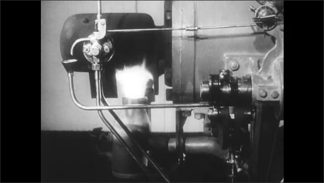 1950s: UNITED STATES: vapouriser heated by blow torch. Man turns fly wheel on machine by hand