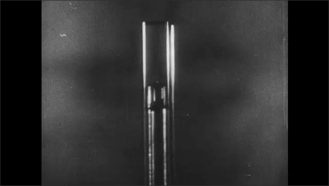 1950s: UNITED STATES: compression inside fire piston. Ignition in piston cylinder. Animation of piston at work