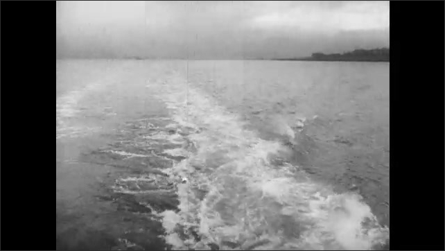 1950s: UNITED STATES: ship on maiden voyage to Bangkok. Wake behind diesel powered ship. Brand new diesel driven ship at sea