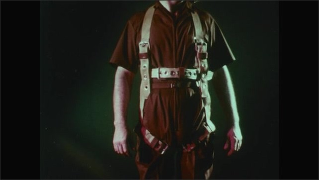 UNITED STATES : A janitor demonstrating the proper cords and jumpsuit to wear when connect to a lift.