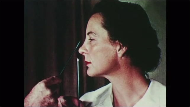 1950s: Artist uses pencils to measure part of woman's face.
