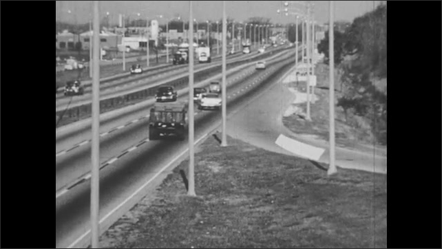 1950s: Car merges onto highway.  Animated line appears in merge lane and extends onto road.