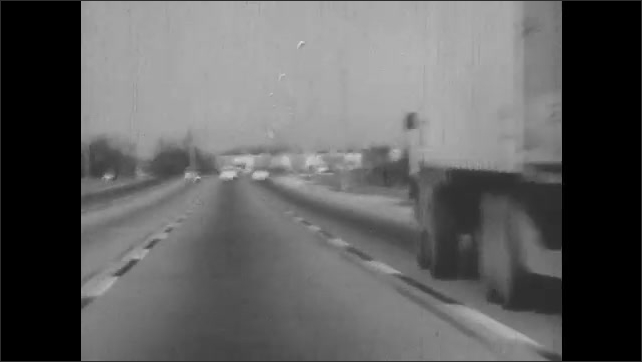 1950s: Cars race down highway.  Men glare at each other.  Hands on steering wheel.  Tire spins.  Man looks scared.  Foot presses brake.  Bumper.  Car stops quickly.