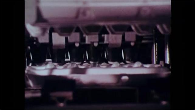 1970s: Machine packs egg cartons.