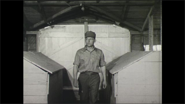 UNITED STATES 1940s : Man Walks Past a Laying House