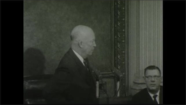 1950s: United States: president listens to question. President laughs in conference. President speaks into microphone. President nods head