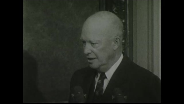 1950s: UNITED STATES: close up side profile of president's face. President speaks to press at conference. President folds arms