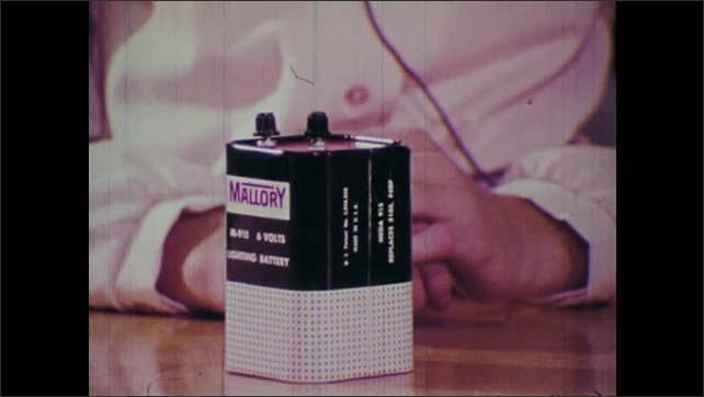 1970s: Girl displays large battery.
