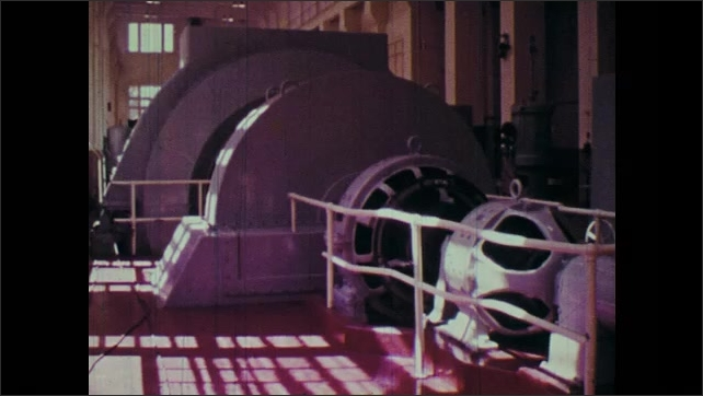 1970s: Lightbulb lights up. Generator in a power station. Hydroelectric dam.