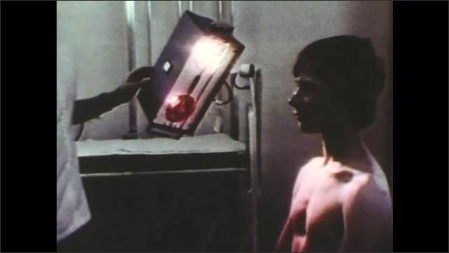 1970s: Hand presses buttons on remote control. Man watches tv with remote control in hand. Nurse shines infrared light onto boy's chest. Man pushes down toaster.