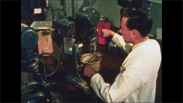 1960s: UNITED STATES: rubber gloves on production line. Man uses electron microscope to study PVC particles. PVC particles under microscope