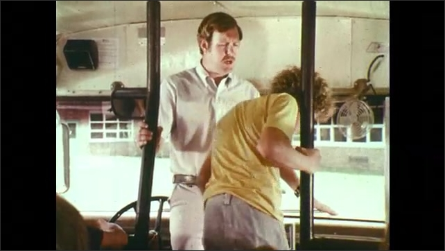 1970s: UNITED STATES: driver evacuates students through front door. Driver picks students to lead evacuation from bus