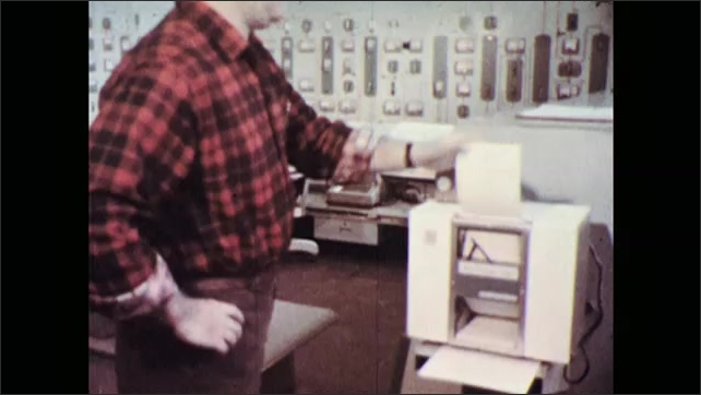 1960s: Pan across oil refinery. Tracking shot, low angle view of refinery. Man rips paper in office. Tracking shot of refinery. Man with test tubes, zoom in on liquid. Liquid in tube.