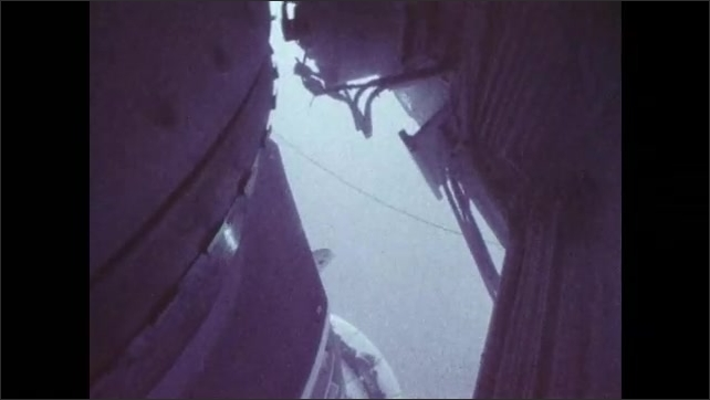 1980s: Underwater, a deep-water pipeline is attached to the bottom of a laboratory vessel