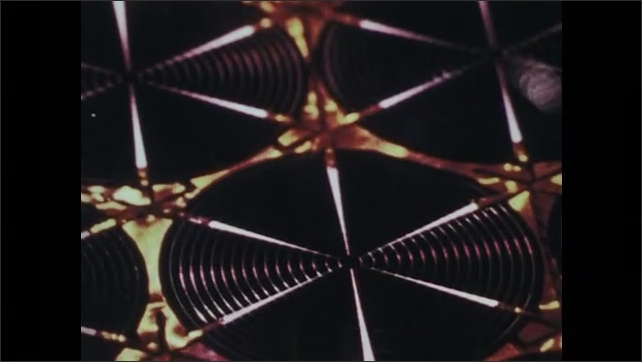 1970s: Computer monitor flickers. Man observes photovoltaic cells through microscope. Banks of solar panels in desert. Photovoltaic cell.
