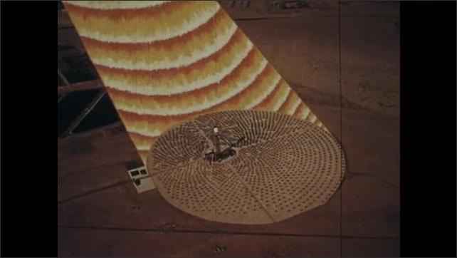 1970s: Animated solar ray moves toward Earth. Animated solar ray moves through clouds. Animated solar ray shines on solar power plant.