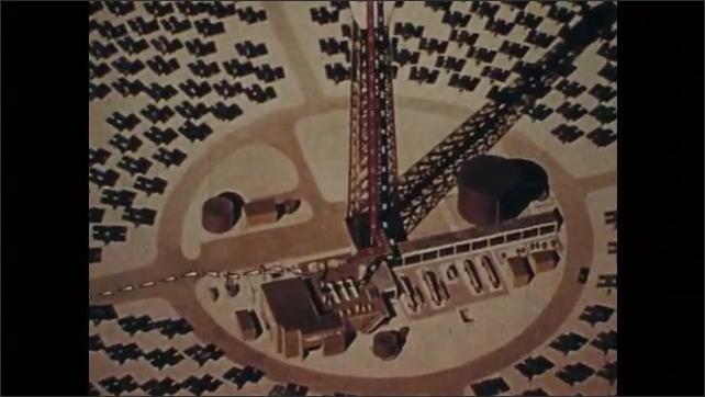 1970s: Animated solar ray shines on solar power plant. Animated lines move along solar power plant tower to turbines.