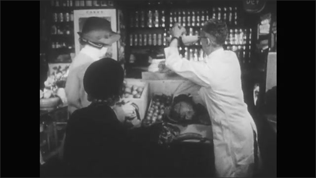 1940s: Woman exits building. Woman and girl enter building. Grocer weighs apples, places them in bag. Woman hands wallet to girl, girl pays grocer.