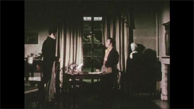 1950s: Man at desk, man enters, men shake hands, sit at desk.