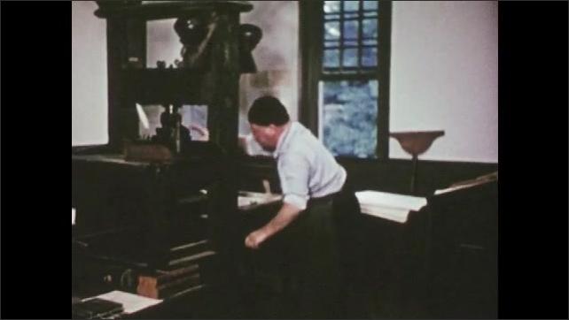 1950s: Men at table, pan of man walking across room, man picks up gun. Man working printing press.