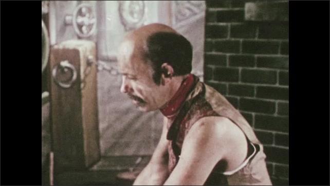 1950s: Men talking in factory. View of man. Man talking. Men in factory.