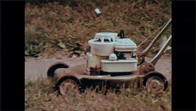 1970s: Zoom in on blender. Man working at construction site, zoom in on jackhammer. Tracking shot of lawnmower. Motorboat on lake.