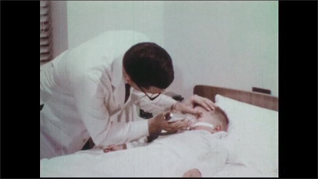 1970s: Man and woman walk to shed. Hand displays lock on door. Man and nurse stand near shed and talk. Doctor examines boy in hospital bed. Doctor checks pulse of child.