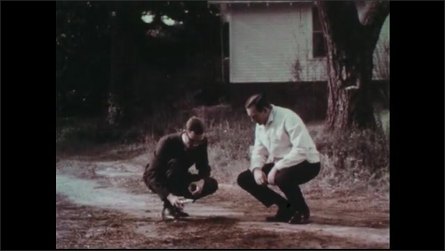1970s: Nurse writes on clipboard. Mother and nurse talk in home. Men kneel near driveway. Man removes sample of soil from yard. Hands and trowel scoop soil into jar.