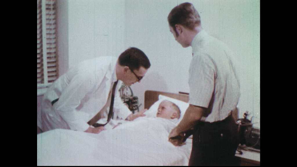 1970s: Doctor and father talk to boy in hospital bed. Doctors consult chest x-rays. Nurse and mother talk at home.