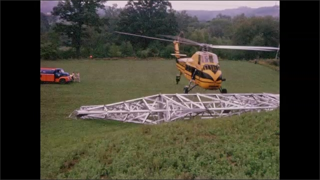 1960s: UNITED STATES: helicopter on ground. Helicopter hovers above ground