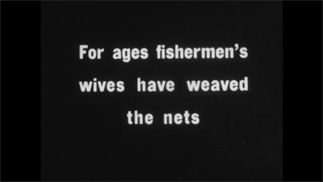 1930s: A woman walks in the water and carries a package on her head. Intertitle ????or ages fishermen????s wives have weaved the nets???? A woman sits on the ground and weaves a net.