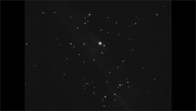 1930s: Space.  Animation.  Sun and stars move through sky.