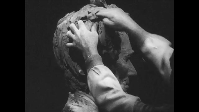 1950s: Close up, hands sculpting clay bust, change hair on head.