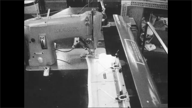 1960s: Woman loads strip of fabric into holder, places holder into machine. Machine runs fabric through sewing machine.