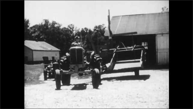 1950s: Man climbs onto tractor, drives past camera.